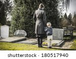 woman with child at graveyard | Shutterstock . vector #180517940