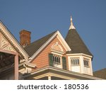 This is a colorful shot of a victorian homes roof.  - stock photo