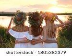 Young Women Wearing Wreaths...