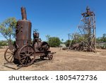 Historic machines from the mining industry. Open air museum from the Australian gold rush era of 1870s. Pine Creek used to be a gold mining town. Pine Creek, Northern Territory NT, Australia