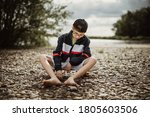 Young Teen Boy Child Sit On...