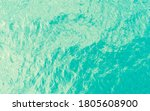 Aerial view of a crystal clear sea turquoise water texture. View from above Natural blue background. Turquoise water reflection. Blue ocean wave. Summer sea. Drone. Top view - stock photo