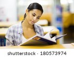 young college girl reading a...   Shutterstock . vector #180573974