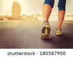 a woman with an athletic pair... | Shutterstock . vector #180587900