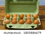 Dozen Eggs In Green Cardboard...