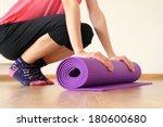 woman with yoga mat | Shutterstock . vector #180600680