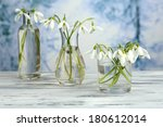 beautiful snowdrops in vases on ... | Shutterstock . vector #180612014