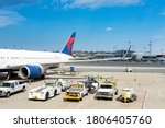 Small photo of BOSTON LOGAN INTERNATIONAL AIRPORT, BOSTON, MASSACHUSETTS, USA - AUGUST 23, 2020: Ground operations at Logan Airport, the largest U.S. airport north of New York City.