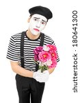 Sad Mime Artist Holding A...