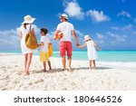 back view of a happy family on... | Shutterstock . vector #180646526