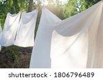 White Bedding  Clothesline...