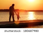 father and son walking out on a ... | Shutterstock . vector #180687980