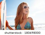 beautiful young woman surfer... | Shutterstock . vector #180698000