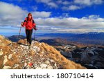 Young Hiker Steps On The Rocky...