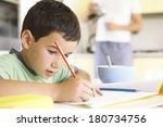 young boy doing his homework | Shutterstock . vector #180734756