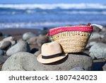 Beach Bag And Sun Hat On The...