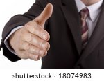 Businessman shaking hands in friendship or conclusion to a meeting - stock photo