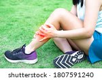 Small photo of A woman athlete had a leg injury in the calf caused by excessive sports. Thigh muscle pain caused by strenuous exercise. This injury is often caused by a variety of sports such as running, soccer