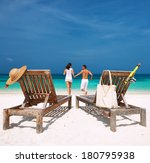 couple in white running on a... | Shutterstock . vector #180795938