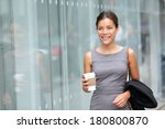 Постер, плакат: Business woman walking drinking