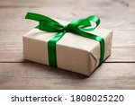 Gift Box With Green Ribbon On...