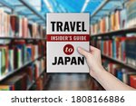 a hand holding a travel guide...   Shutterstock . vector #1808166886