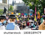 Small photo of PARLIAMENT SQUARE, LONDON/ENGLAND- 1 September 2020: Police liaison officers and protesters on the first day of two weeks of Extinction Rebellion protests in London