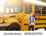 Masked Bus Driver Looking At...