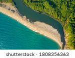 Beautiful sandy beach surrounded by sea waves on one side and on the other by the waters of a river that flows into the sea, the mouth of Veleka River at the Black sea coast, Bulgaria
