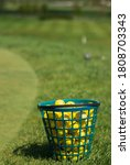 A Basket With Yellow Golf Ball...