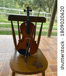 Violin On A Chair With A Deep...