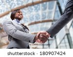 business people shaking their... | Shutterstock . vector #180907424