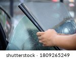 Small photo of Close up of car window tint installation. Ceramic film provide heat rejection & UV protection. Automotive film installed to car glass surface. Professional tinting service background. Hand moving