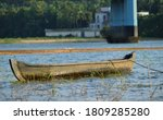 A Floating Wooden Boat On River.