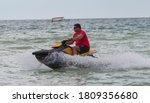 Lifeguard On A Jet Ski Patrols...