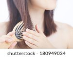 Japanese Woman Combing Her Hai...