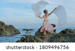 magical fairy posing on a rocky ... | Shutterstock . vector #1809496756