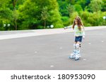 young girl riding on roller... | Shutterstock . vector #180953090