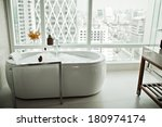 modern bathroom interior with... | Shutterstock . vector #180974174