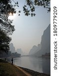 A Hazy Scene Along The Li River ...