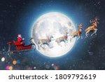 Santa claus in a sleigh ready...
