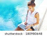 woman working on her laptop... | Shutterstock . vector #180980648
