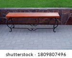 A Comfortable Wooden Bench With ...