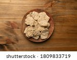 Raw dehydrated soy meat or soya chunks on wood background top view. Texturized vegetable protein, also known as textured soy protein or TSP