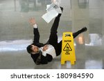 Senior Businessman Falling On...