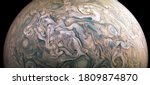 Jupiter planet in outer space close-up, photo of gas clouds taken by spacecraft. Texture surface of Jupiter, giant atmospheric turbulence. Solar System concept. Elements of image furnished by NASA.