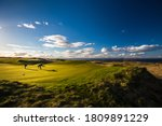 Small photo of Golfers on a lovely golf course in St. Andrews, Scotland