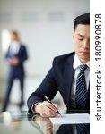 serious businessman reading... | Shutterstock . vector #180990878