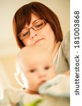 mother holding and admiring her ... | Shutterstock . vector #181003868