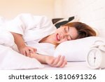 Small photo of Asian woman sleeping on the bed and grinding teeth,Female bruxism,Gnash or clench your teeth